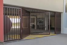 8 Porte pliante TWIN barreaudée